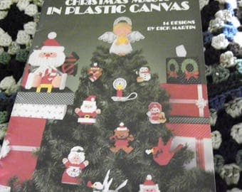 Plastic Canvas Book - Christmas Magic - 14 Designs Snowman, Santa, Mrs. Claus, Nativity, Bear, Noel, Angel, Bird, Candle, Basket, Caddy, Box
