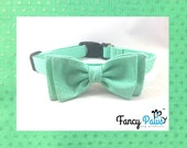 Traditional adjustable dog collar in mint green with small polka dots