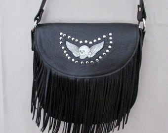 Black leather cross body bag .