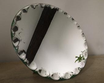Former beveled round mirror.