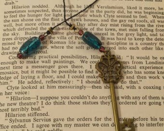 Bronze key bookmark with blue and purple beads