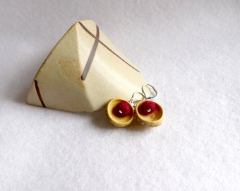 Wooden earrings, little carved wooden rounds with little red handfelted wool pearls