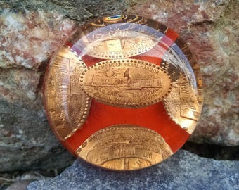 Mid Century Pearl Harbor elongated penny lucite paperweight
