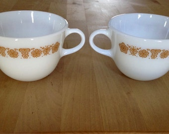 two vintage Pyrex milk glass cups gold flowers