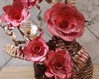 Floral composition with recycled newspaper paper