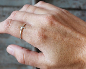 Small cross made by hand in small, vertical bar ring, sterling silver ring