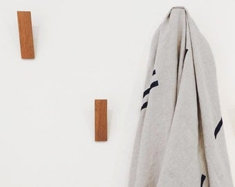 Oak Wood Wall Hook with Simple, Minimal Design. Beautiful accessory for a modern interior for hanging coats, towels and more.