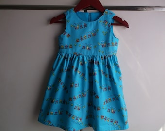 Trains on turquoise dress