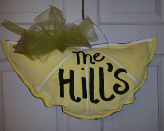 Yellow lemon door hanger.  Perfect for Spring or Mother's day.  Brighten up your curb appeal.  Burlap back