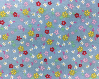 Fabric Remnant - Cotton - White, Yellow, Light Pink & Dark Pink flowers on a Blue background.