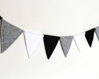 Cheerful flags line of felt black, a party