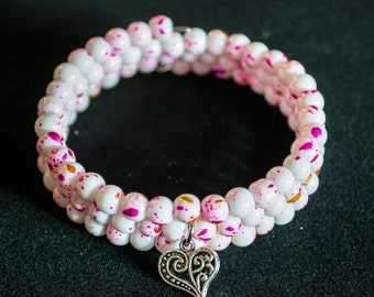 White and pink beaded memory coil bracelet with silver heart charm