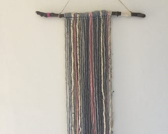 Pink and grey wall hanging, yarn and stick wall hanging, grey yarn wall hanging
