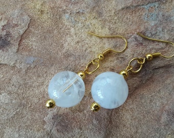 White and gold drop/dangle bead earrings with large,  white ,accent beads surrounded by tiny gold colored metal beads and gold findings