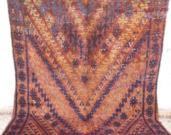 Stunning carpet beni'mguilte with bleu pattern and brown