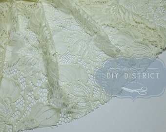 Fabric lace motif ivory flower.