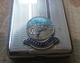 vintage chrome plated matchbook holder engine turned with crest of Conway Castle