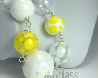 White polka dots over yellow and claer glass big beads.  hollow glass big beads. Handmade. Fine silver and silver plated wire and findings