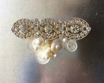 Shabby Chic refrigerator magnet made of buttons, pearls, shells and an upcycled pin.