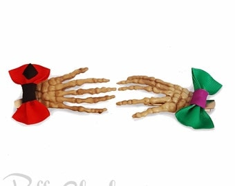 Set of Skeleton Hands Hair Clips with Harley and Joker Bow by CreepyCheeks