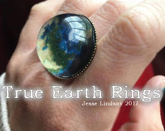 True Earth black light reactive RINGS! Show the whole world you're woke af with this stylish dome in either silver or bronze tones!