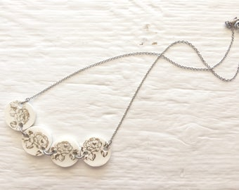 Ceramic necklace | Flowers necklace gold on white