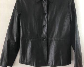 Black leather jacket Banana Republic , woman size small .