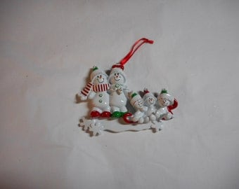 Family of 5 Snowman on sled