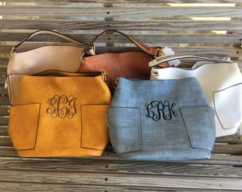 Monogramed bucket style bag with extra bag inside