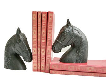 Cast Iron Horse Head Bookends with books