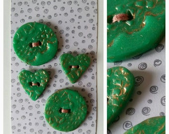 Set of 4 green and gold polymer clay buttons.