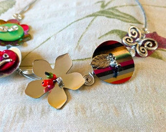 Handmade artistic necklace with charms and flowers