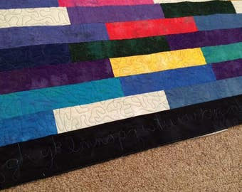 Quilt with alphabet quilted