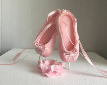 Ballerina shoe (ballet slippers) with flower cake topper made out of fondant