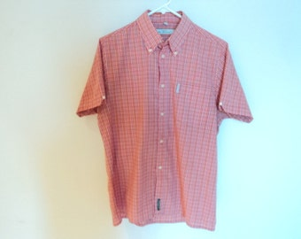 Shirt for man. Vintage mens clothing. Shirt with short sleeves and checkered. Red and white color. Vintage Sherman.