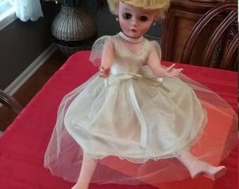 Vtg. Sleepy eye bride doll w/rooted blonde hair and pearl earrings