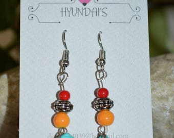 The nature feel with this red, orange and blue beaded set of dangle earrings