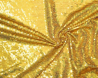 Fabric solid sequin stretch gold  58 inches wide. Sold by the  1/4 Yard