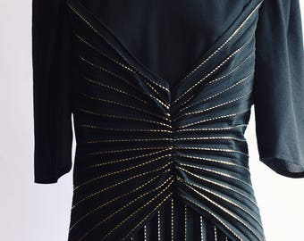 Welted black party dress in gold
