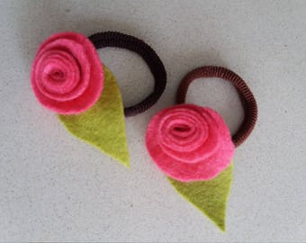 Rubber newcoletero with 2 units, felt flower hairpins