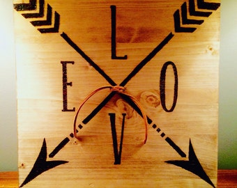 Rustic arrow love sign