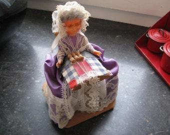 Beautiful old doll: Woman side hacks ... ca. 1950.
