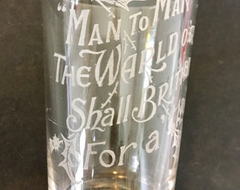Glass shot glass with words by Robert Burns engraved along with thistles