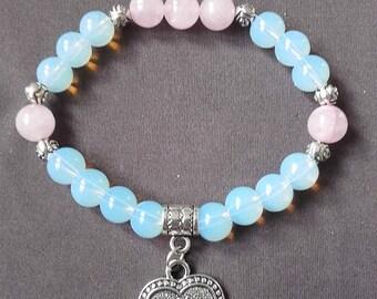 "Bracelet ""Tenderness"", celestial blue opal and pink quartz, charm Om, about 18 cm."