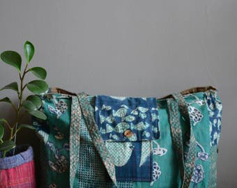 Hand block printed , hand-spun and handwoven khadi tote bag , khadi bag , reversible bag , quilted bag .