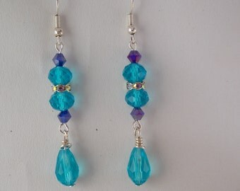 In blue glass bead earrings