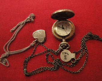 Silver ladies pocket watch by rotary and a silver pendant