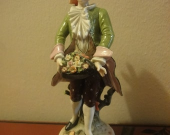 German figurine of a dandy  presenting a flower posie height=20cm
