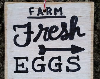 Hand painted, black and white Farm Fresh Eggs ornament sign on reclaimed wood.