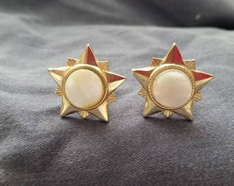 Vintage 1960's gold star cuff links with a mother of pearl circle